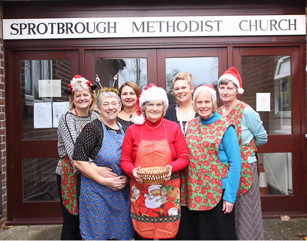 New Beginnings Team Leader Clare Robinson (third from right) and Senior Practitioner Terez Nagy (third from left) with members of Sprotbrough Park Methodist Church at their fundraising Christmas lunch.
