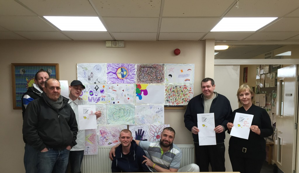 Service users with the artwork they created during their Mindfulness session