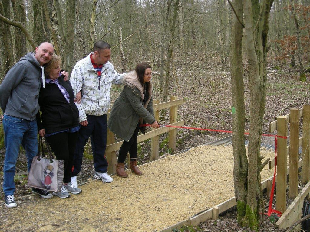 Service users from New Beginnings watch Terez Nagy cut the official ribbon at Potteric Carr's Discovery Zone.