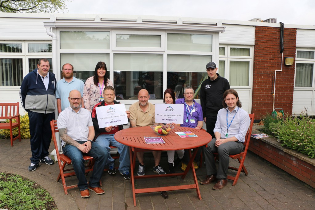 RDaSH Cognitive Behavioural Therapist Dennis Convery (seated right) with Aspire's Day Programme Manager Paul Wade (seated left) and Team Leader Lesley Chimes (back row third from left) with service users at the Mental Health Awareness Week event at New Beginnings.