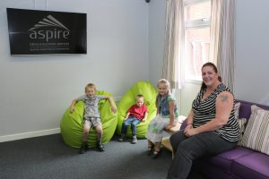 A family sitting in New Beginnings Family Room