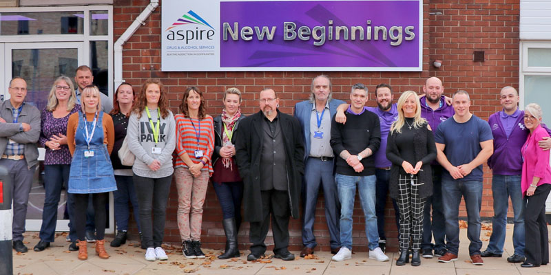 Aspire Volunteer/Peer Mentor Coordinator Lydia Rice (fourth from left) is pictured with peer mentors and visitors to the event at New Beginnings.