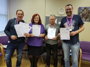 Aspire peer mentors with their certificates