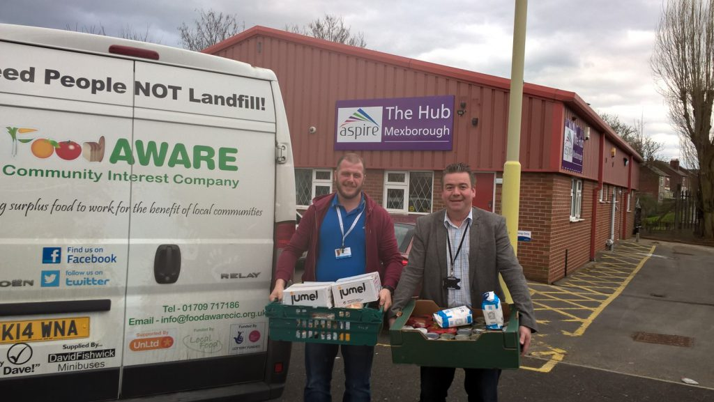 Pictured with the donation are Aspire Case Manager Neil Firbank (left) and Cllr Sean Gibbons (right).