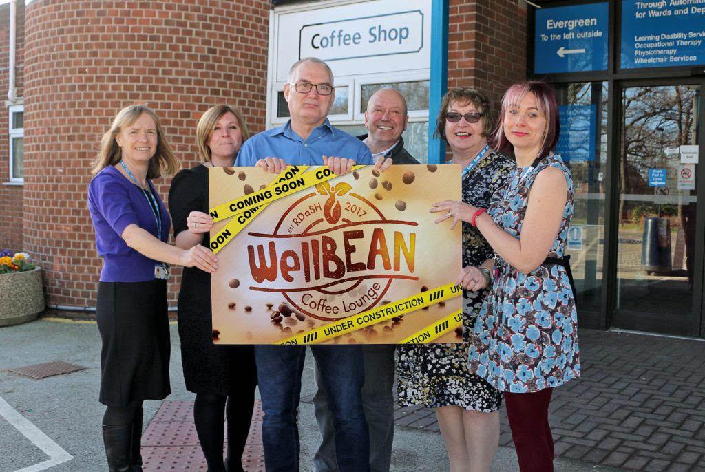 Members of joint RDaSH, Aspire, and Flourish Enterprises WellBean Coffee Lounge project team pictured outside Tickhill Road Hospital.