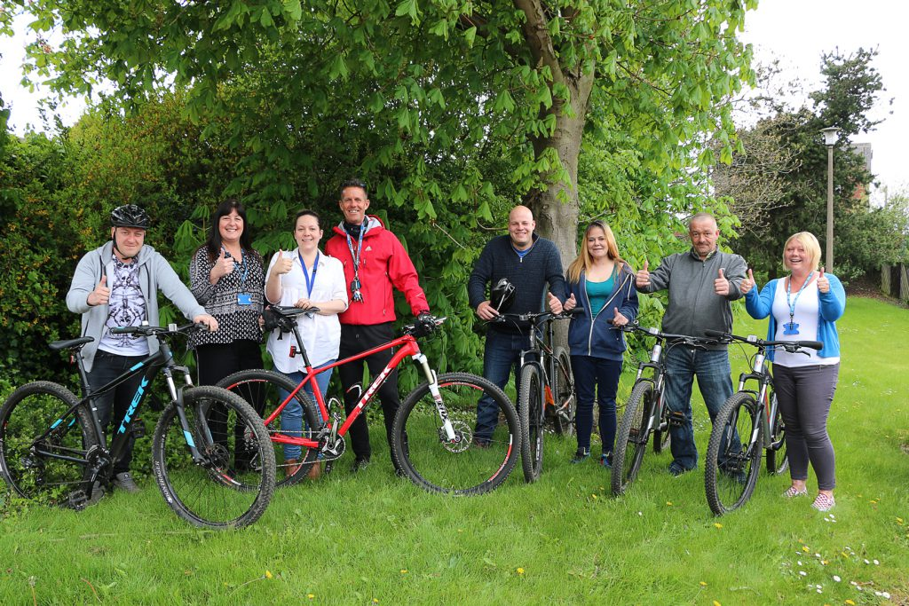 Aspire New Beginnings Team Leader Lesley Chrimes (second from left) and Chris Green of Doncaster Community Leisure Trust (fourth from left) with Aspire staff and service users preparing for a stress busting bike ride around Balby.