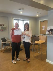 2 people holding certificate
