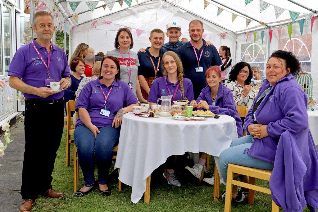 Neil Firbank is pictured fourth right with volunteer mentors and some of the people at the event.